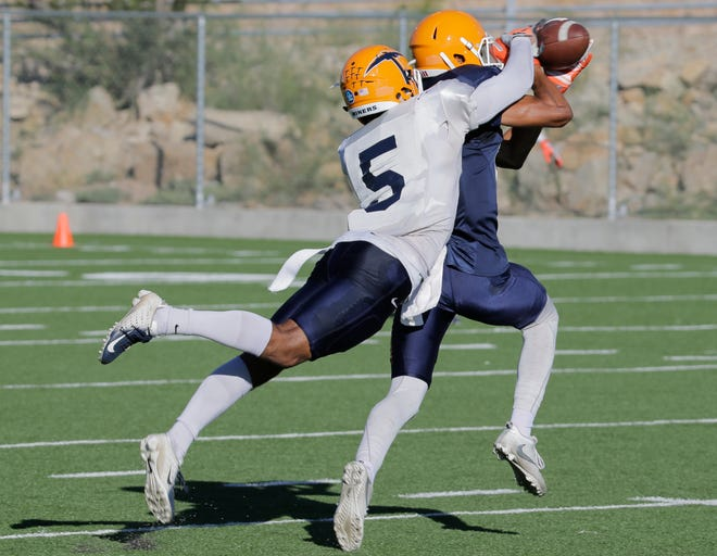 UTEP defensive back Nik Needham applies defensive pressure on Camryn Curtis Dozier and strips the ball during practice Wednesday morning as the Miners prepare for this week's opponent, the University of North Texas Mean Green.