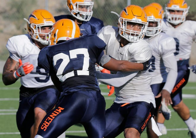 UTEP running back Kriston Davis attempts to keep defensive back Nik Needham out of the backfield during practice Wednesday morning as the Miners prepare for this week's opponent, the University of North Texas Mean Green.
