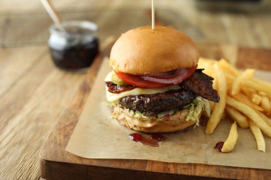 At Lazy Dog Restaurant & Bar locations in Oxnard, Thousand Oaks and beyond, seasonal menu items include the PB & J Burger topped with havarti, peanut butter, grape jelly and candied bacon.