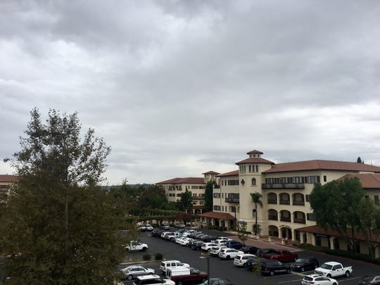 Clouds hover over a Camarillo business center as a light mist falls around noon on Wednesday.