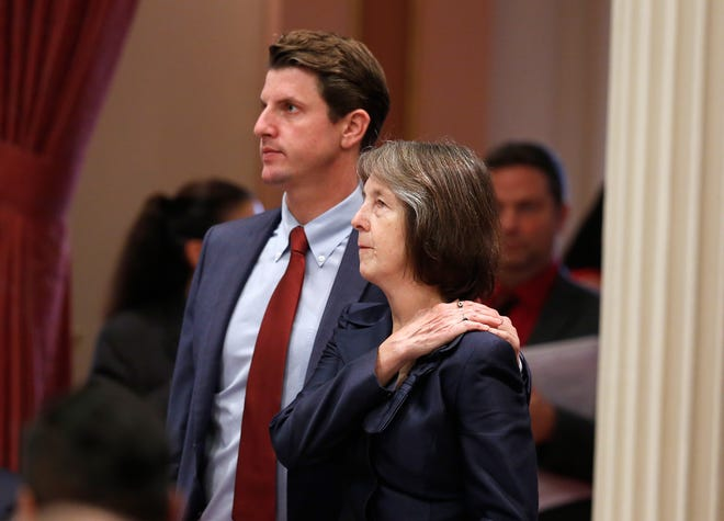 In this Aug. 30 photo, state Sen. Nancy Skinner, D-Berkeley, is joined by Sen. Henry Stern, D-Canoga Park, as she watches the votes posted for her measure limiting the state's felony murder rule in Sacramento. It was among the criminal justice bills signed by Gov. Jerry Brown in a final flurry of legislation before he leaves office in January.