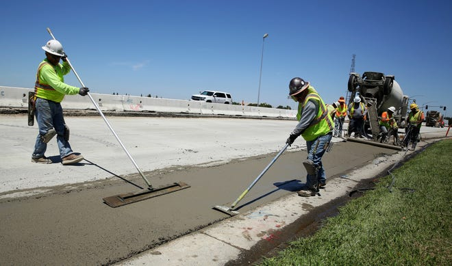 In this July 11 photo, workers repave a street in Roseville that was partially funded by a gas tax increase passed by the Legislature in 2017. Leaders of the Proposition 6 campaign to repeal California's recent gas tax increase are asking the federal government to investigate their claims that public resources have been used against them. A spokeswoman for the anti-Proposition 6 campaign countered the allegations, saying the campaign follows all laws.