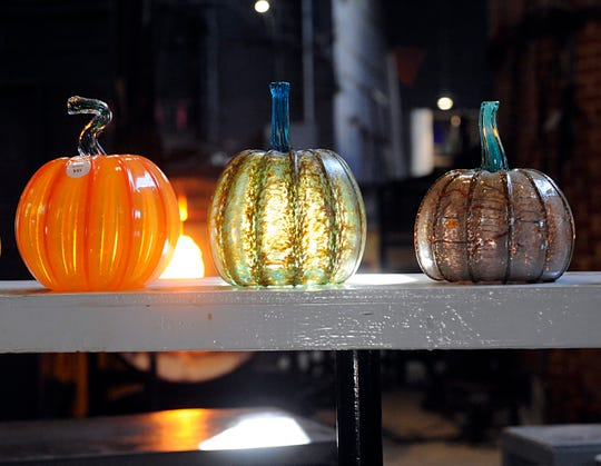 Beautiful glass pumpkins on display during a glass blowing demonstration at Wheaton Arts and Cultural Center in Millville.