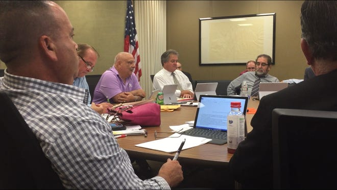 Vineland City Council heard at their Tuesday night work session from representatives of a company looking to put a cannabis dispensary in the city if it gets one of six licenses New Jersey plans to issue soon. Council President Paul Spinelli (center, pink shirt) told the representatives their biggest problem was cultivating favorable local opinion.