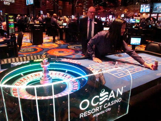 A dealer pushes a stack of chips toward a gambler at the Ocean Resort Casino in Atlantic City.