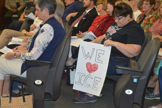 Michelle Moore, a Tulare resident, attends the Truth Act forum on Wednesday in Visalia.
