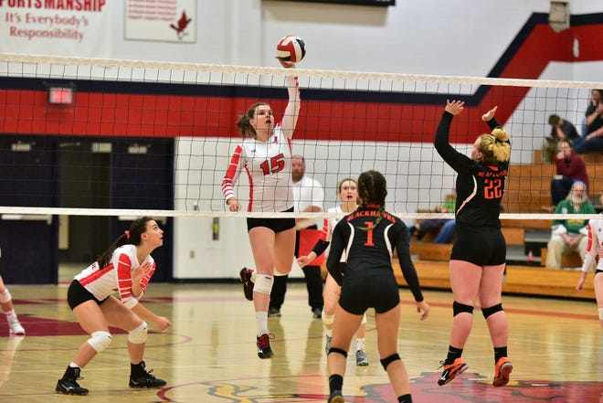 Sarah Mueller of Pacelli Catholic High School gets a kill over Port Edwards on Tuesday, Oct. 2, 2018.