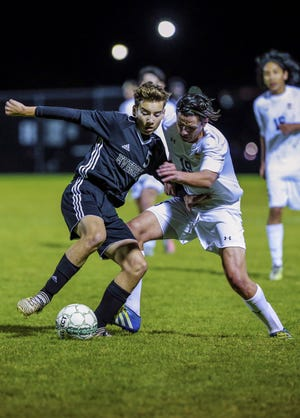 Everest's Ben Halambeck, left, and West's Austin Federici, battle for the ball during a Wisconsin Valley Conference boys soccer game on Tuesday, Oct. 2, 2018, in Weston.
