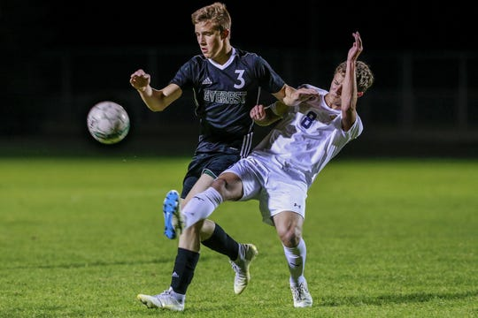 Everest's Gabe Carter, left, tries to get past Wausau West's Jordan Durr during the first half of a Wisconsin Valley Conference boys soccer game Tuesday, Oct. 2, 2018, in Weston.