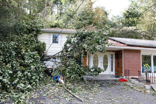 A tree rests on top of a house on Shingle House Road in Millwood.  Reports that a tornado touch down on Tuesday evening causing a clean up in the area of Shingle House Road and Route 100 in Millwood on Oct. 3, 2018.