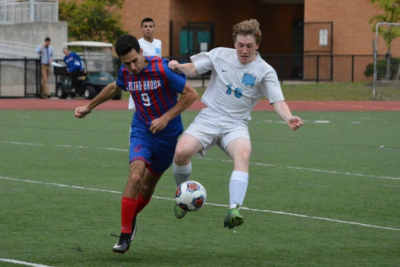 Rye Neck midfielder Owen Robertson holds off Blind Brook defender Jack Shapiro during the second half.