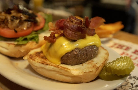 The Blazer Burger at the Blazer Pub is topped with bacon, cheese and carmelized onions.