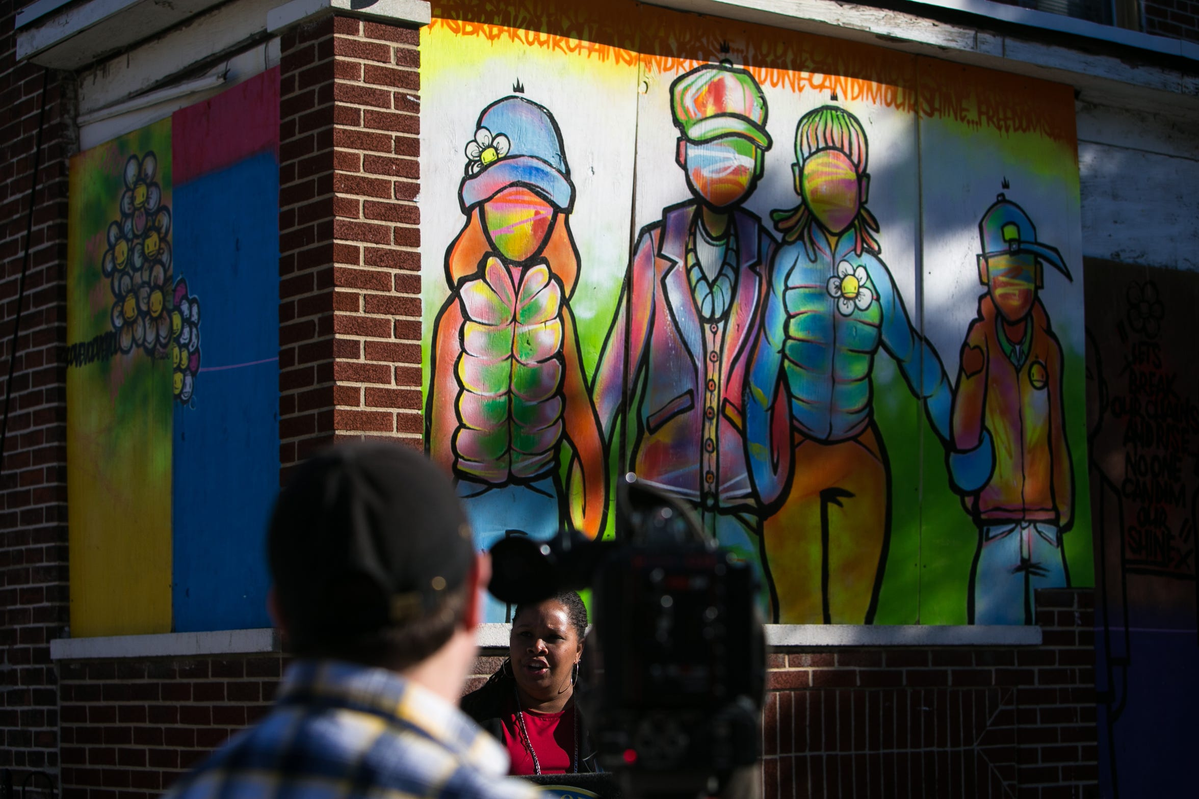 Community art on a vacant home in the Southbridge neighborhood in Wilmington.