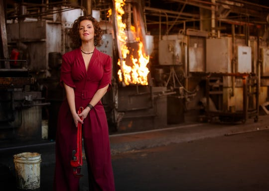 Sharin Macpherson wears a red jumpsuit from Miss Candyfloss with polka dot black suede pony hair pumps by Lulu Townsend.