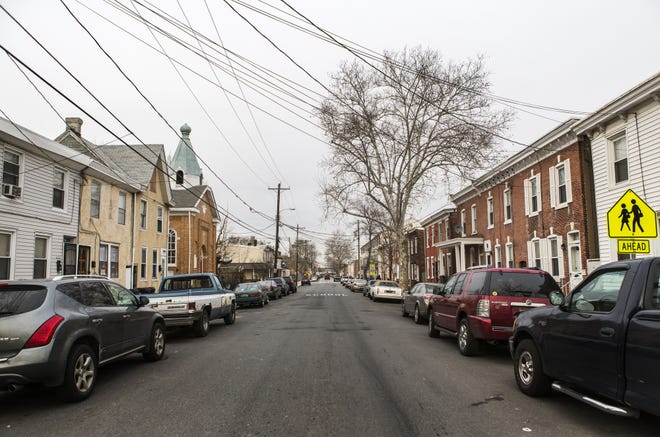 Homes and cars line the sides of  South Claymont Street in Wilmington's Southbridge neighborhood in January 2016.