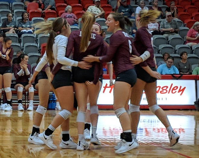 Bowie celebrates winning a point against Holliday Tuesday, Oct. 2, 2018, in Holliday.