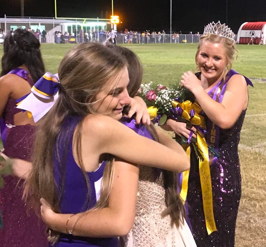 Senior Madison Thompson (right) was named Munday's Homecoming Queen at Saturday's festivities.