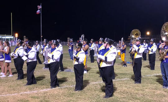 The Munday band performs its routine after the Moguls' Homecoming football game.
