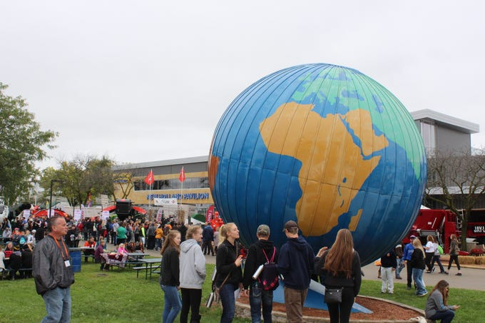 The large iconic globe is a popular place to take selfies.