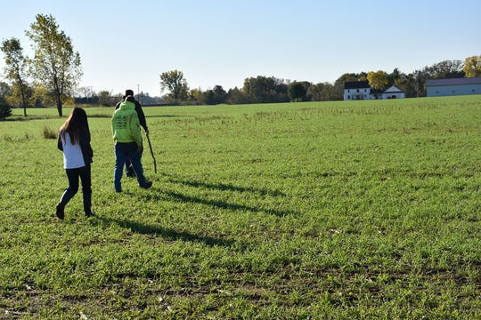 Derek and NRCS employees inspecting cover crop growth.