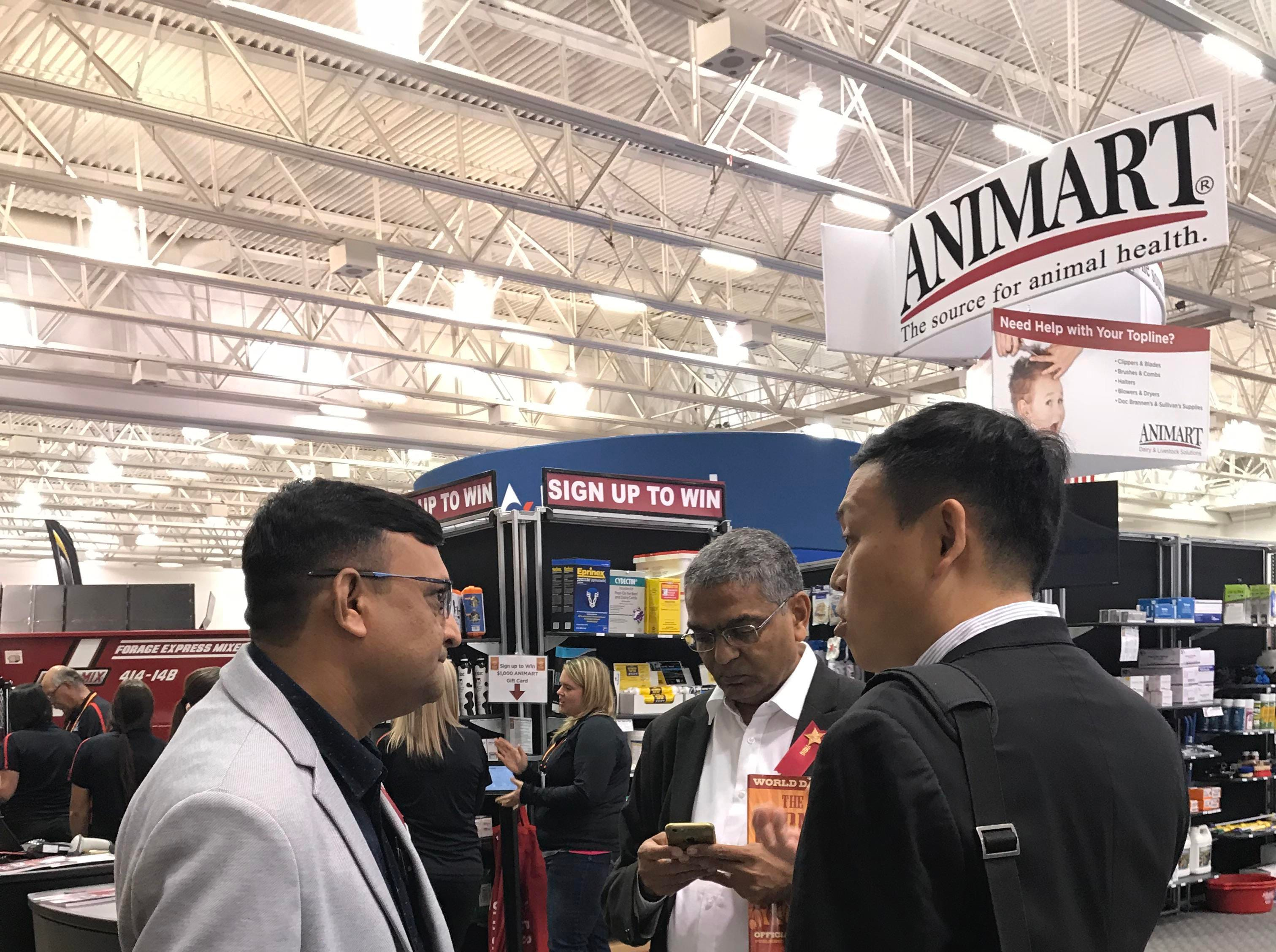 International visitors check out the Trade Show inside the Exhibition Hall.