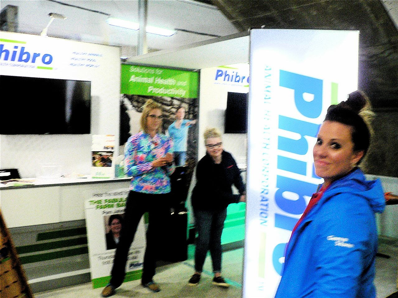 Breeana DeVerger (right) views the completed Philbro exhibit and says there will be about 40 people manning it over Dairy Expo.
