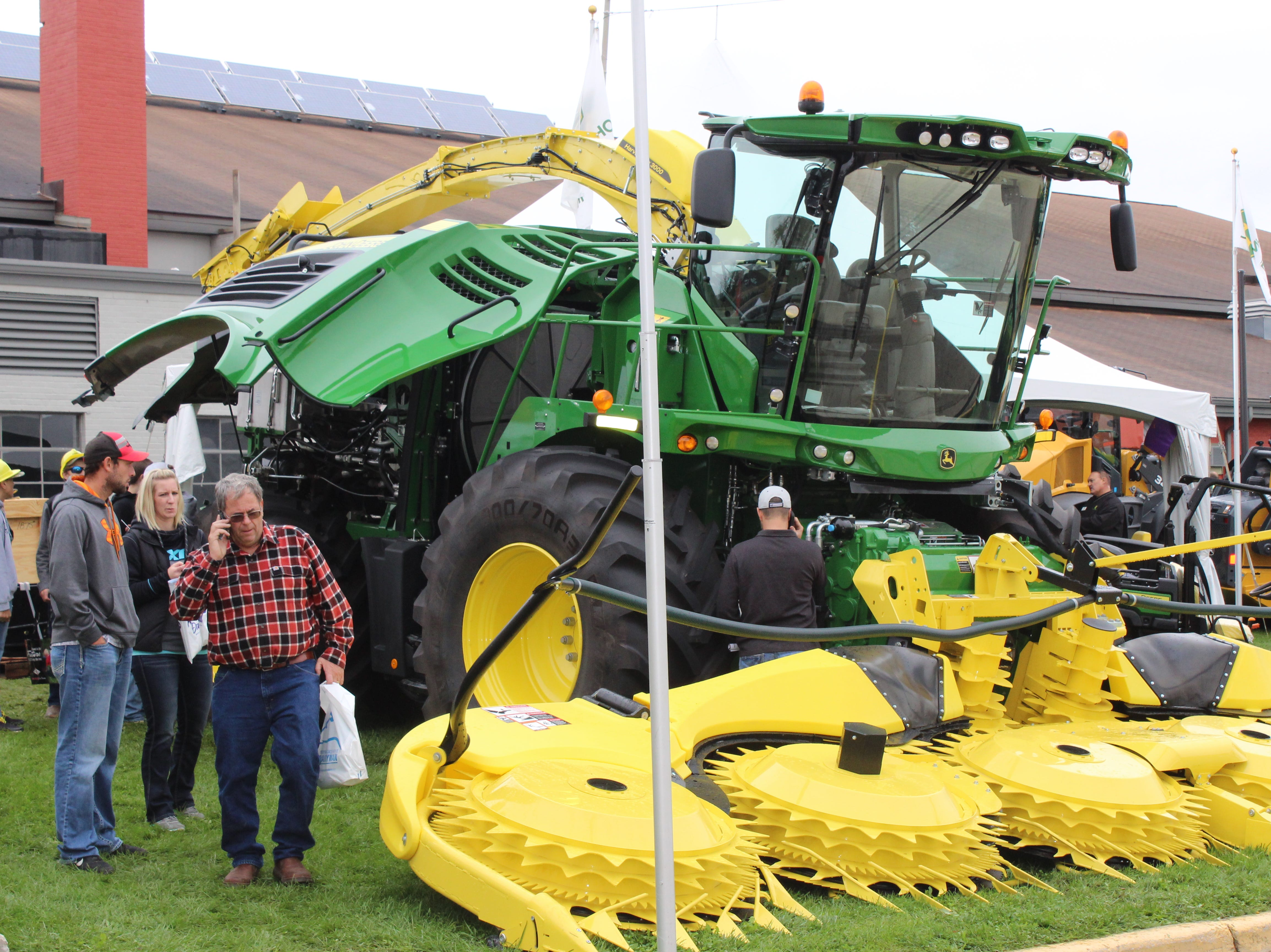 Checking out the latest and greatest farm machinery.