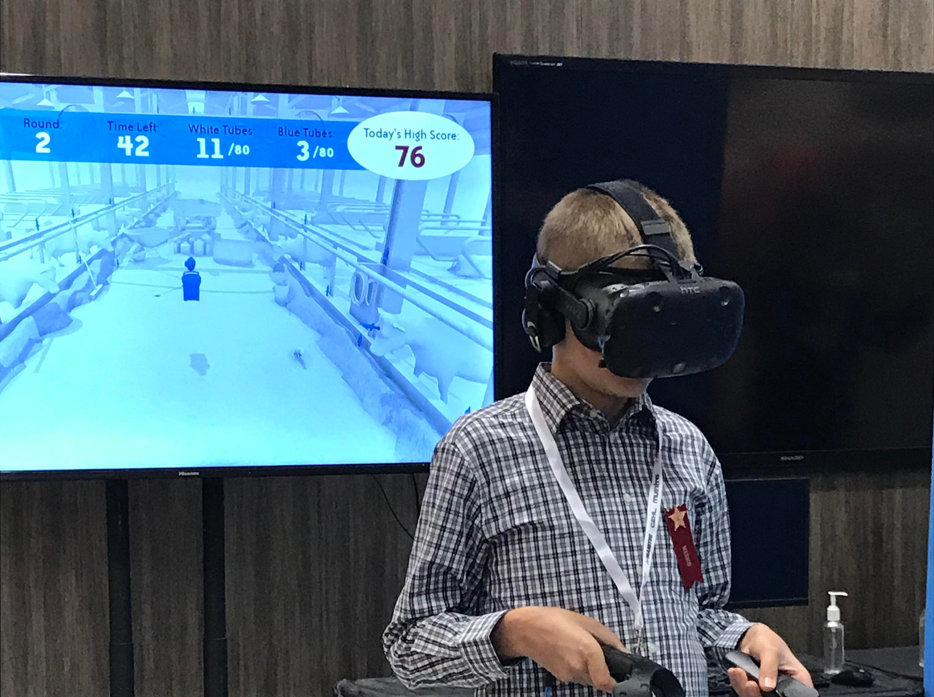 This young visitor uses virtual reality to test out a product at the Trade Show.