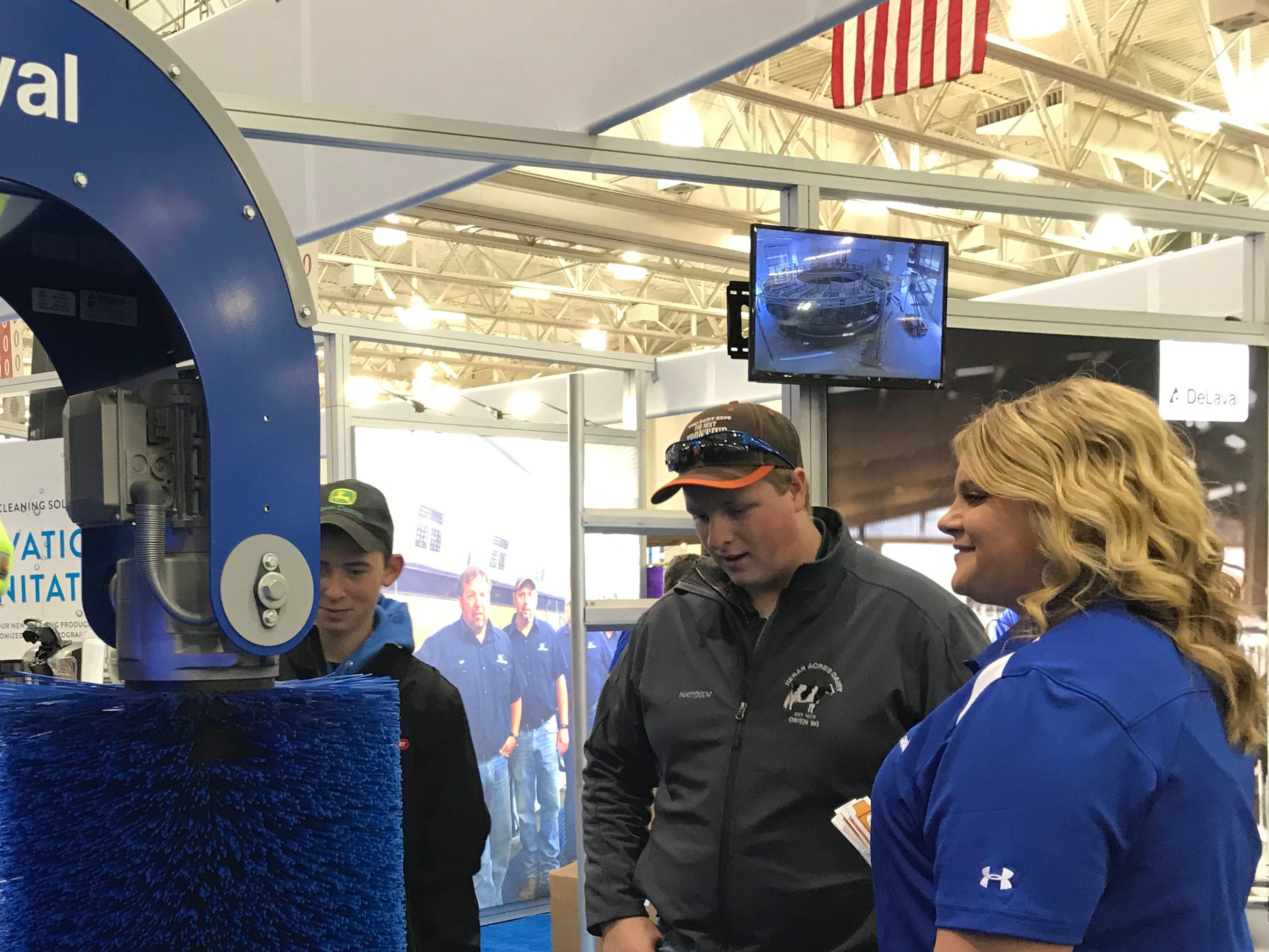 Checking out cow comfort equipment at a DeLaval exhibit.