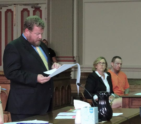 Assistant Prosecutor John Litle reads the statement of facts prior to Ryan Adams being sentenced to life in prison.