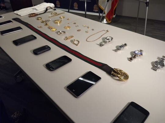 The Los Angeles Police Department displayed stolen items recovered from one suspect's home at a press conference on Oct. 2, 2018.