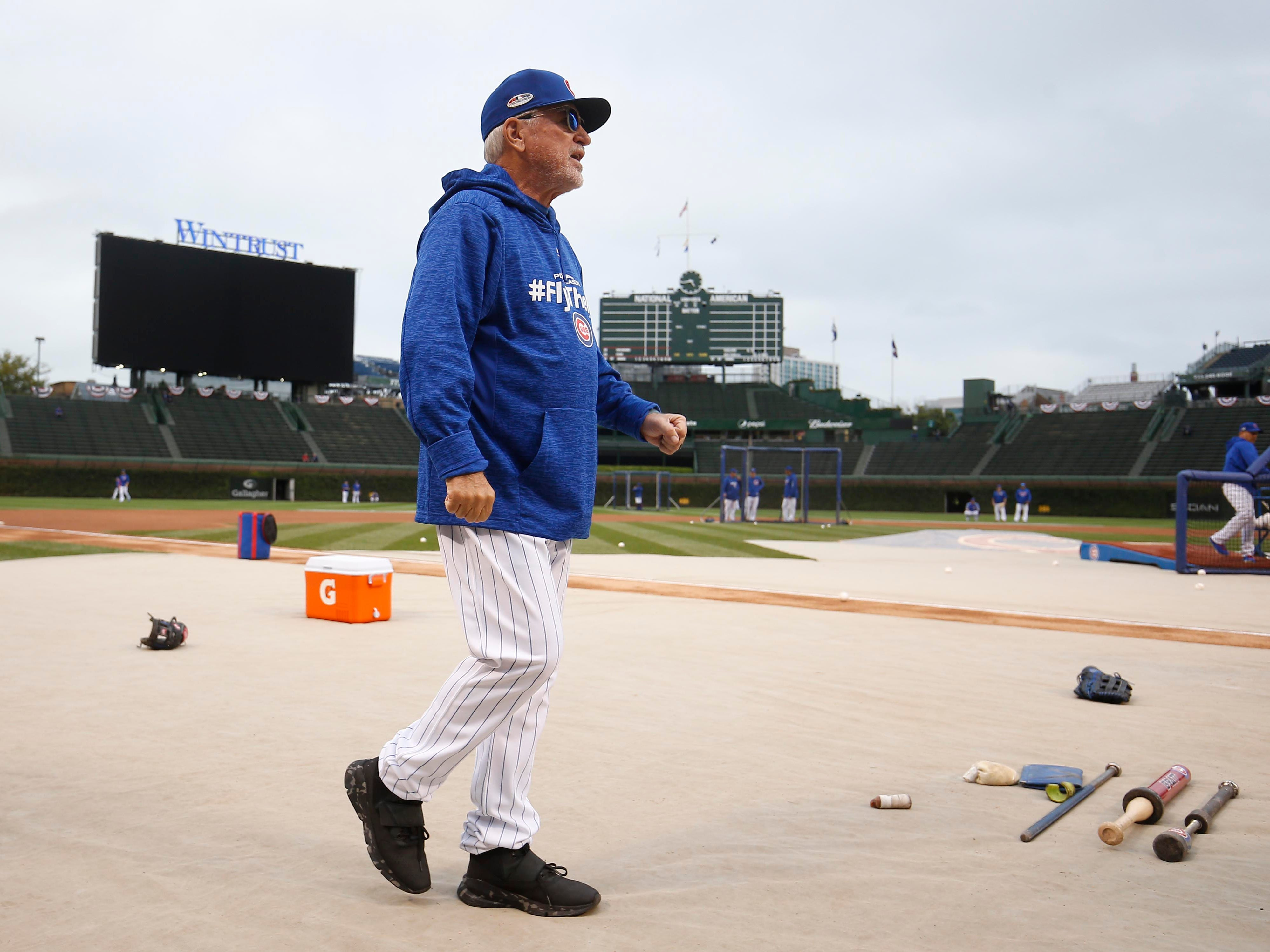 NL wild card: Cubs manager Joe Maddon walks on the field during pregame drills.