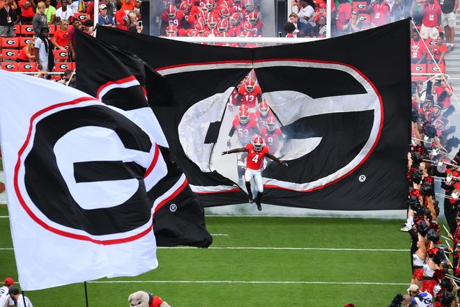 A Georgia baseball player has been dismissed from the team for using a racial slur against the Bulldogs' QB.