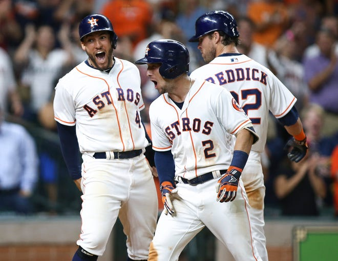 The Houston Astros have been doing their fair share of celebrating over the past year, thanks in part to the contributions of (L-R) outfielder George Springer, third baseman Alex Bregman and outfielder Josh Reddick.
