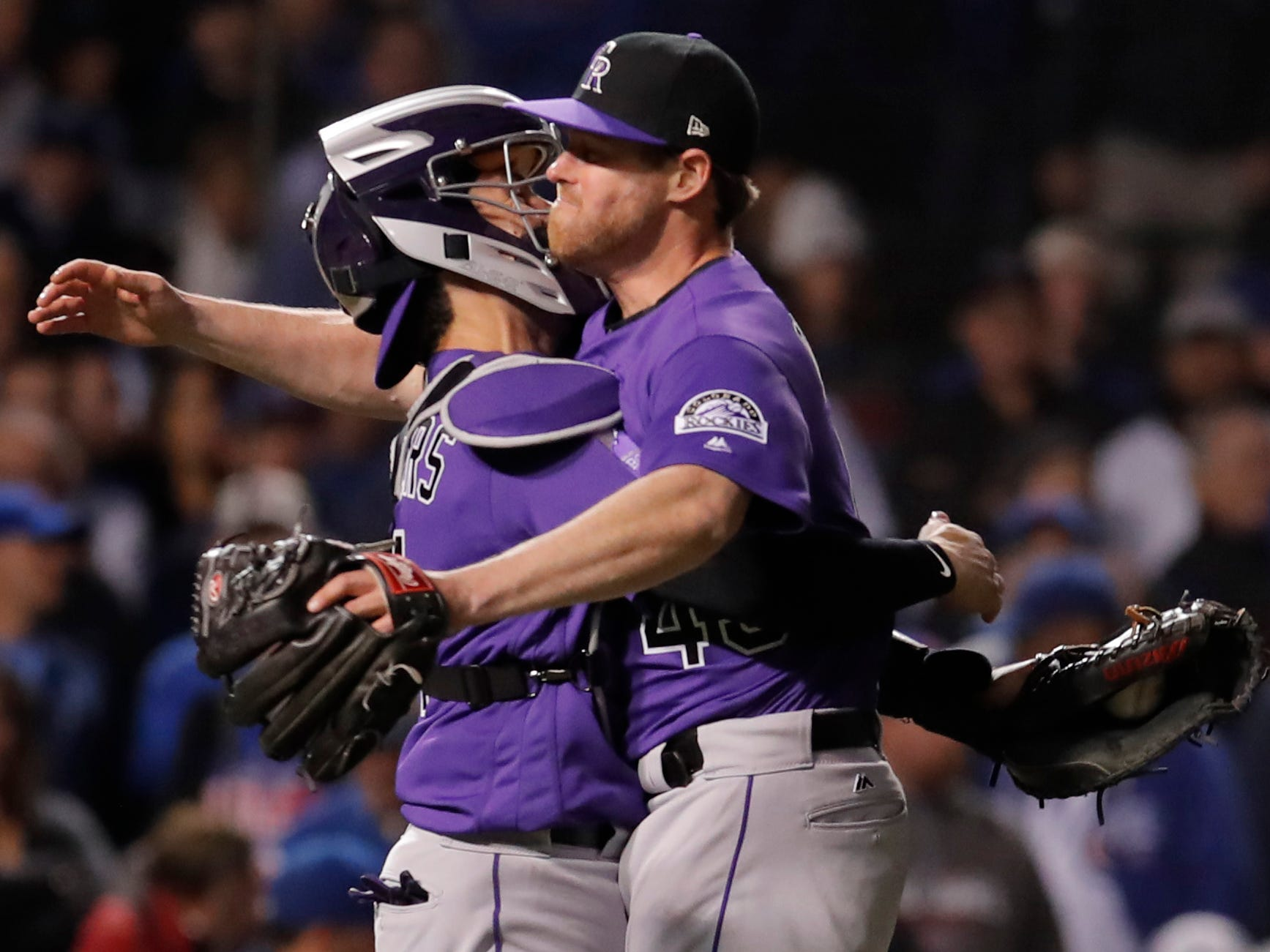 Rockies relief pitcher Scott Oberg celebrates with Tony Wolters after defeating the Cubs in the National League wild-card game at Wrigley Field.