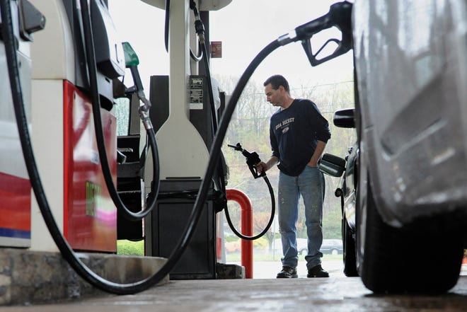 John Magel pumps gas at a station in Wethersfield, Conn. , in this 2011 file photo