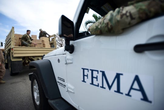 Department of Homeland Security personnel deliver supplies to Santa Ana residents in the aftermath of Hurricane Maria in Guayama, Puerto Rico, on Oct. 5, 2017.