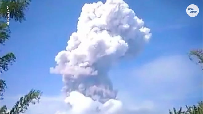 A volcano in Indonesia erupts days after a deadly earthquake rocks the coast.