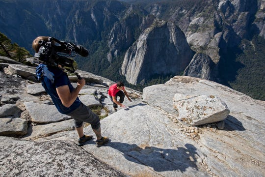 "Clair Popkin, director of photography on ""Free Solo,"" gets a shot of Alex Honnold as he nears the top of the wall."