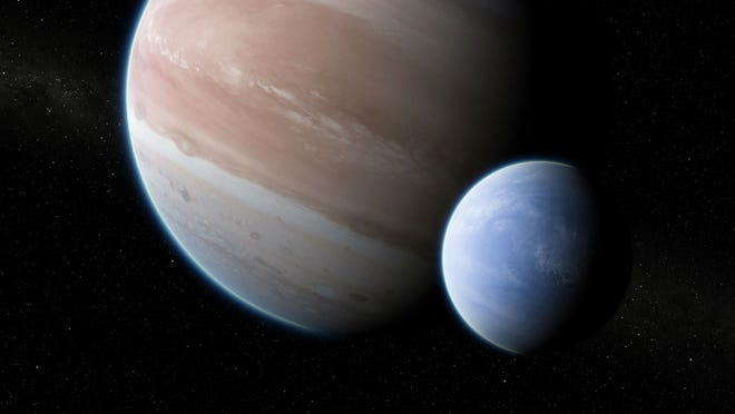An artist's conception of the planet Kepler-1625b (left), with its exomoon in tow (right.)