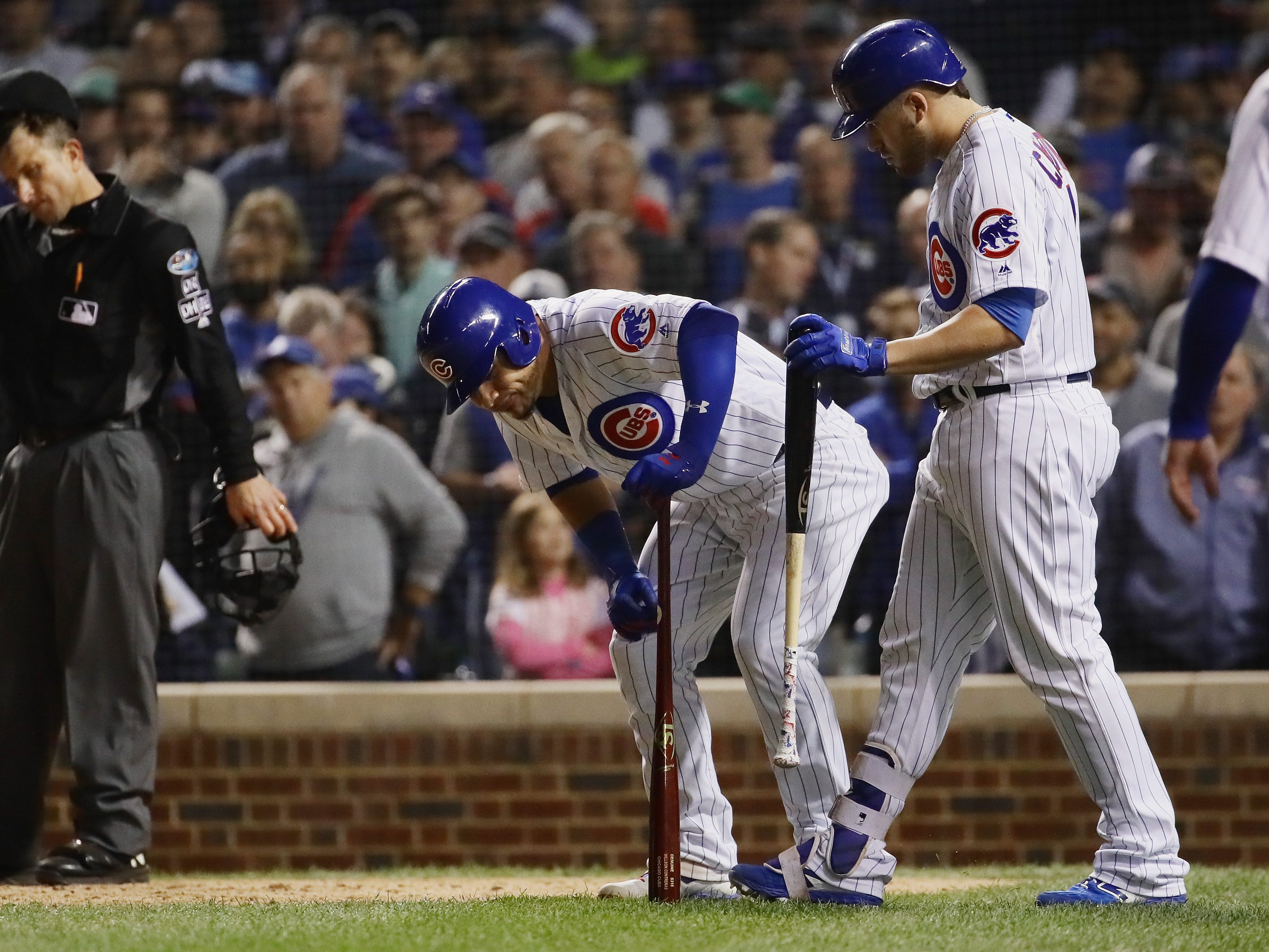 NL wild card: Cubs' Willson Contreras reacts after leg cramp in the 11th inning.