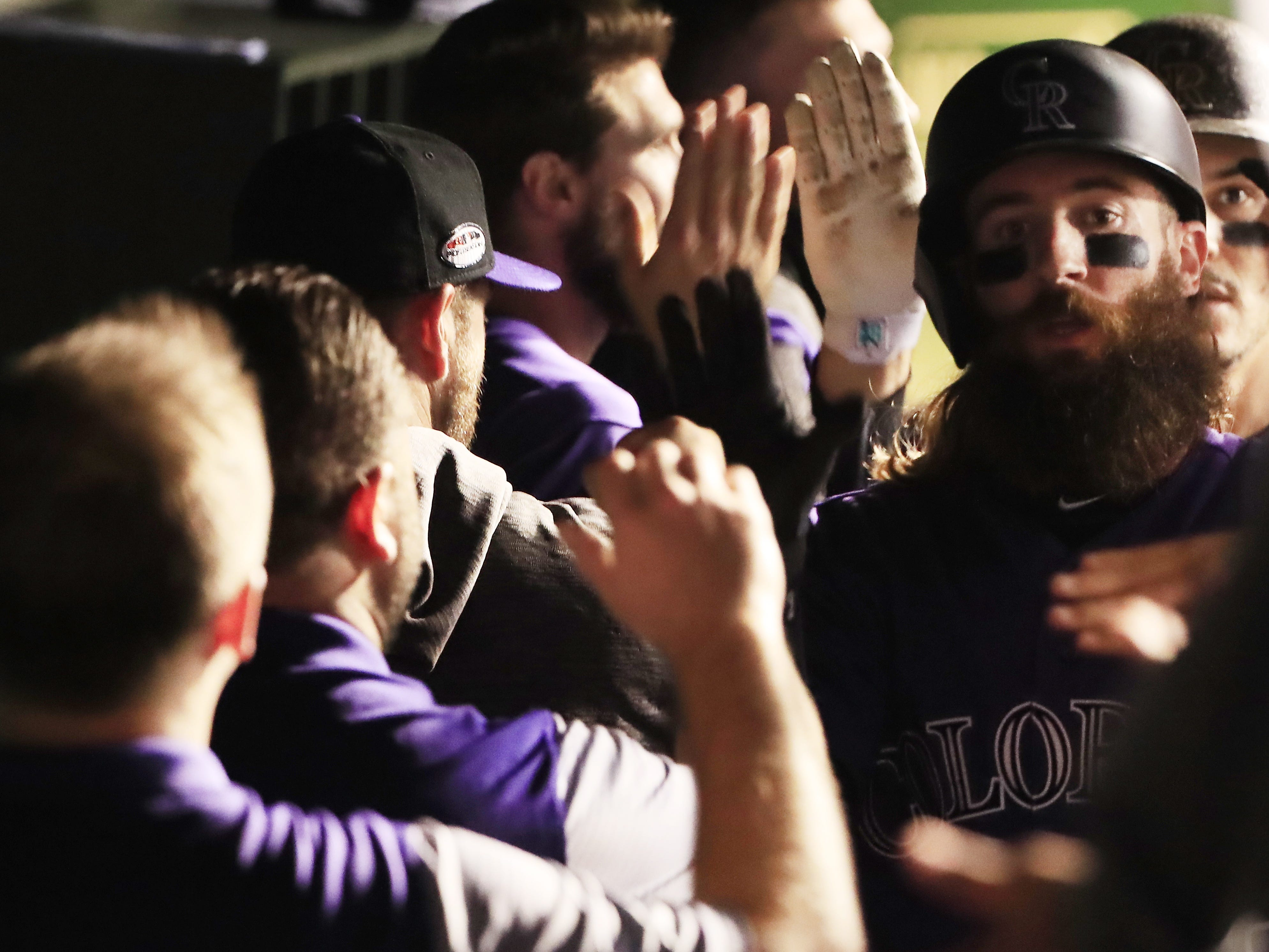 NL wild card: Rockies' Charlie Blackmon scores in the first inning to give Colorado a 1-0 lead.