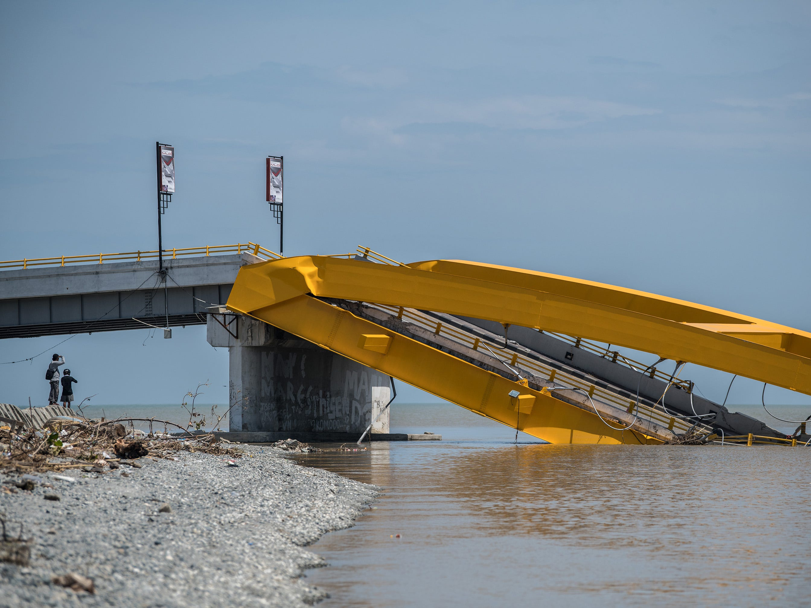A bridge sits destroyed after being hit by an earthquake and tsunami, Oct. 2, 2018, in Palu, Indonesia.