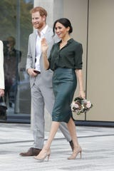 Meghan wore a forest-green leather skirt from Hugo Boss.