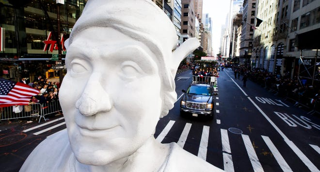 Fifth Avenue stretches out behind a giant bust of Christopher Columbus on the Columbus Citizens Foundation float during a past Columbus Day parade in New York, New York.