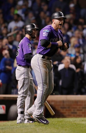 Rockies shortstop Trevor Story scores the winning run in the 13th inning.