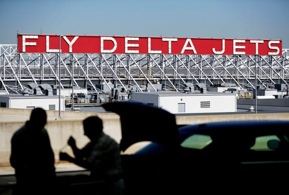 This file photo from Oct. 13, 2016, shows a Delta Air Lines sign overlooking the Hartsfield-Jackson Atlanta International Airport.