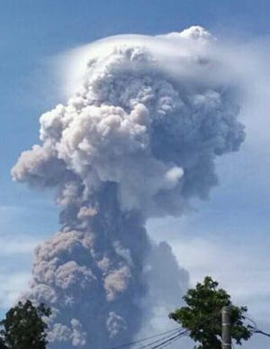 Mount Soputan spews hot ash in Minahasa, North Sulawesi, Indonesia, on Wednesday, Oct. 3, 2018.
