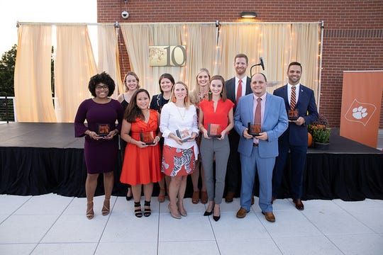 The Roaring 10 recipients were honored at a reception and recognized on the field before the Clemson game against Syracuse.