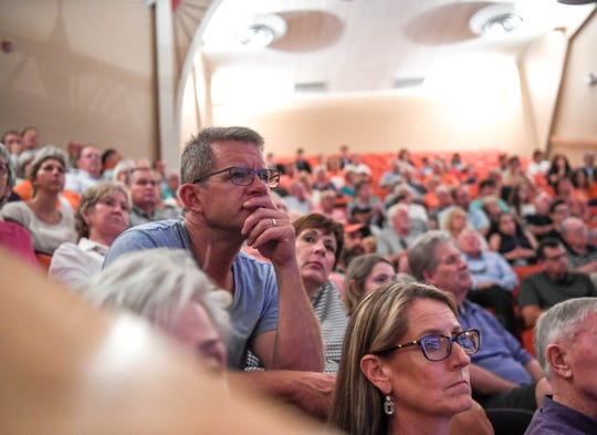 Attendees at Clemson University's Tillman Hall, in Clemson, South Carolina, listen to three prisoners of war on Thursday, Oct. 4, 2018.